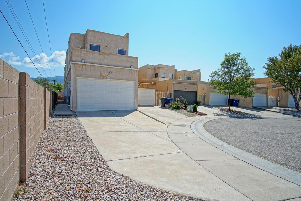 NEW PRICE! Prime NE Heights Location! Located in a Quiet Cul-de Sac. Very Close to a variety of Restaurants, Shopping, CNM, El Oso Grande Park, Biking Paths, and Open Space Bear Canyon. Two Master Suites 1 on ground floor. COOL REFRIGERATED AIR!, Great Room With 13 feet High Ceilings, Gas Fireplace, 4 Seperate Balcony's with great close VIEW of Sandia Mountain. Upper Level Study/Office/Loft Area. Small Low-maintenance Xeriscaped Backyard & Side yard With Storage Shed In Backyard. NO HOA!