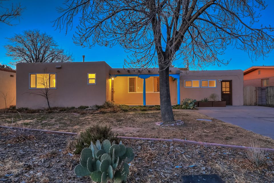 Sweet Nob Hill/UNM home with lovely updates and newly painted. Gleaming hardwood floors and new dual-pane windows. Graciously-sized living and dining room. There is a second living area with a separate entrance for large studio or home office. Enjoy the beautiful yard from the covered patio. Cherry, apple and apricot trees.