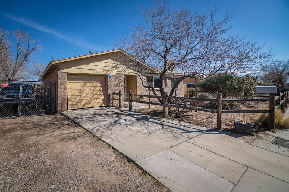Great Near North Valley Home.  This home has three bedrooms, two baths and two living areas with a heated and cooled sunroom.  This great home has a side yard access and plenty of storage.   New Metal Roof and TPO roof installed.