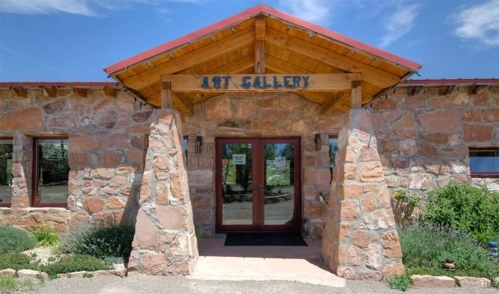 Located along the east side of the Turquoise Trail, just north of Frost Road, in the village of San Antonito, sits this meticulously refurbished, nearly century-old historic schoolhouse affectionately known as The Old Schoolhouse Gallery. Today yoga and massage take place at the Old Schoolhouse with an adjacent building featuring a salon, clay studio, and apartment.The Old Schoolhouse shines with stone walls, rich wood, tile flooring, exposed beams and trusses, diamond plaster walls and a gorgeous floor-to-ceiling rock fireplace. The two buildings are situated on a beautiful, just under 1-acre lot which is zoned Rural Commercial allowing for extremely flexible live/work/rental options.  What an amazing opportunity to live/work in and around a bit of New Mexico history!