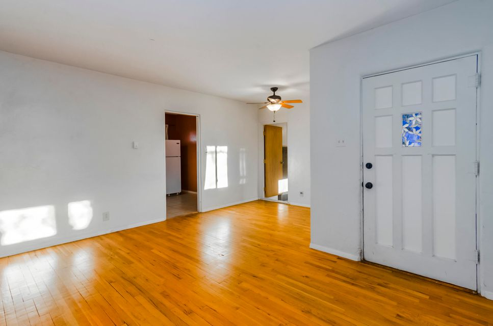 This 3 bed, 1 bath home located in Southeast Albuquerque has strong bones to support many upgrades including 05/2018 Roof Tune Up.  Inside, wood floors adorn the main portion of the comfortable floor plan, while large updated windows allow abundant natural light to illuminate the atmosphere. The kitchen features ample cabinetry and backyard views.  Outside, the welcoming front yard features a large shade-providing tree as well as an updated stone fascia on the front of the house.  As for the backyard, a garden and storage shed provide opportunities to personalize the backyard to any taste. Perfect for anyone who is looking to put in a little TLC for a tremendous reward.