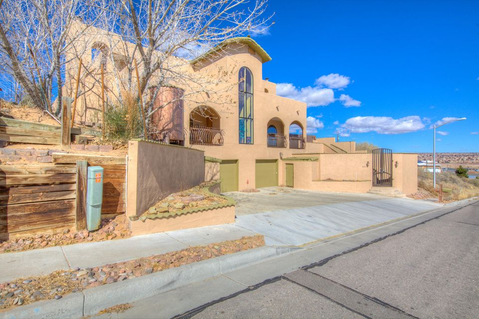 Gorgeous Custom Home!! Must See! Breath Taking Views of the Sandia Mountains! 4 to 5 Bedrooms!  Large Kitchen with Bar! 60'' Gas Stove and Custom Cabinets! 3 refrigerated air units/heater! Cozy Living room with Fireplace! All Brick Flooring throughout! Over sized Master suite of 1000 sq ft with a wood burning fireplace! Plus Coffee Bar! Large Master Bath Has a garden tub with double sinks! Home also has a Central vacuum unit!! Romeo and Juliet balcony!3 cherry trees and Fully landscaped! Bonus room in garage for man cave! Its a Must See!