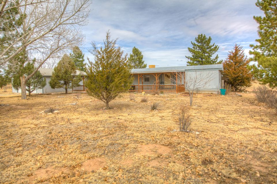 PRICE REDUCED! Lovely home on PERMANENT FOUNDATION situated on over 3 ACRES. This 2 bedroom 2 bath home has an attached great room that is over 400 sq ft (not included in sq ft) Evaporative cooler, DETACHED 2 car garage. Country living with great VIEWS, well cared for home on well and septic.