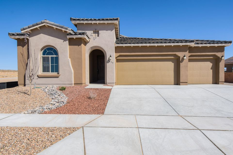 Stunning Mediterranean single story home by Hakes Brothers located in the Trails neighborhood! Home features 2,119 sf with 4 bedrooms, 2.5 baths and 3 car garage! Beautiful wood tile throughout the main living areas. Spacious great room. Open kitchen with upgraded ivory cabinetry, granite countertops, backsplash, gas cooktop, built-in wall oven/microwave, center island with seating space, pantry and dining area. Gorgeous master suite with spa like bath. Bath hosts a garden tub, walk-in shower with tile surround, dual sinks and a huge walk-in closet. Additional gust rooms with plenty of space. Outside enjoy the covered patio with built-in fireplace and private backyard. Come see what the Hakes Brothers has to offer!