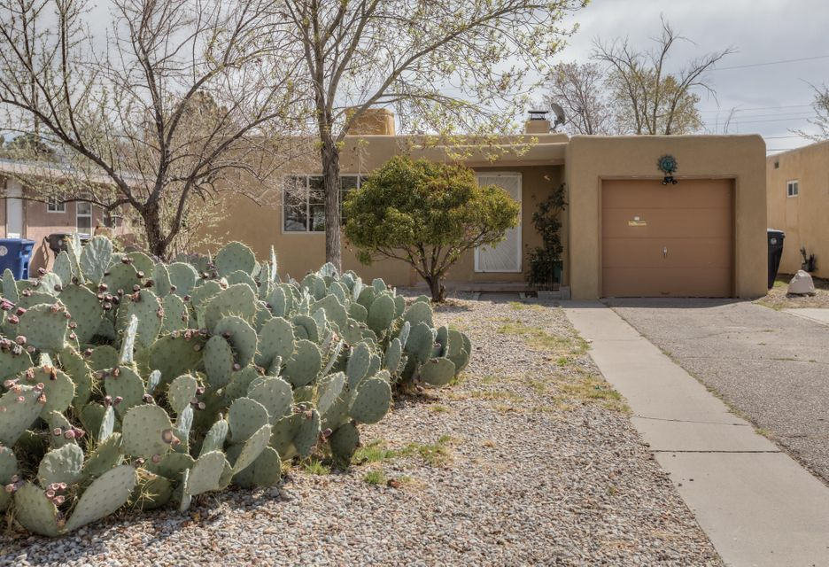 Great value on this charming 3 bedroom home with hardwood floors, spacious living area with a wood burning fireplace, lots of cabinet space in the kitchen, large master bedroom with french doors leading to the backyard, full bath plus a 3/4 bath adjacent to the master bedroom, nicely sized bedrooms, central heat, thermal windows, 1 car garage, huge backyard, all appliances convey.