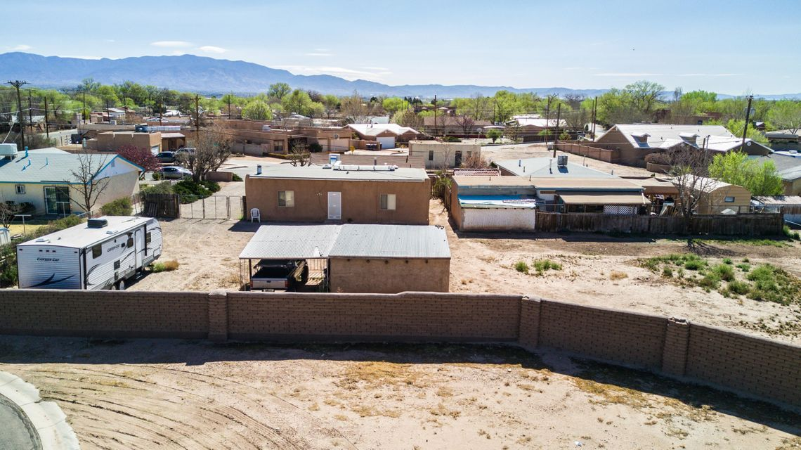 Awesome opportunity to own this unique north valley home. This 2 bed 2 bath adobe home is currently on a total of .43 acres and can be broken into 2 different lots one being .2273 and the other .2090. Paperwork already done and approved if you'd like to build another home on site. Great location and great opportunity!!