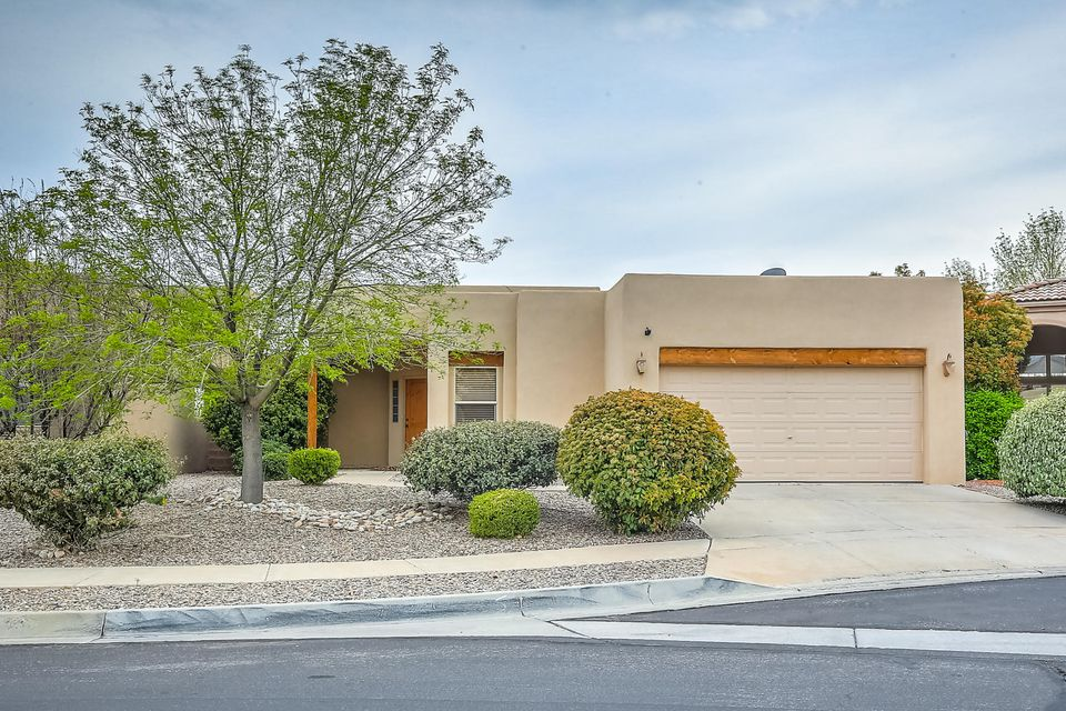 Looking for that perfect family home? This unique four-bedroom home near Cottonwood Mall is the one! The newly remodeled kitchen opens into an inviting, high-ceilinged dining and living room. With just a step out of the living room to the balcony, take in the best views in the neighborhood. Soak in sweeping views of the mountains and city or use the spiral staircase down to the backyard. As you walk through the house notice the new tile and carpet. The master bedroom will stop you in your tracks. It allows for the perfect escape every evening with a two-way glass fireplace, tub, walk-in closet, and sliding door out to the covered patio.