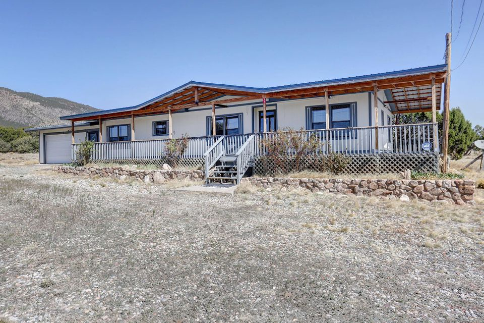 Wrap around Mountain Views you have been waiting for! This property has an amazing wrap around porch that has been very well kept. The house has an additional 2 car fully finished garage, Panel Roofing, Private Propane tank, sitting on 15 acres! This is an amazing property that will not last long.