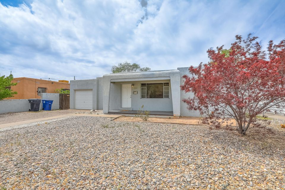 Move In Ready 3 bedroom/1 & 1/2 bathroom /1 car garage home w/ Covered Patio and a Huge Backyard. Original refinished Hardwood Floors. Open Floor Plan, with updated kitchen including All Appliances to convey: gas range, refrigerator, dishwasher, and microwave oven. Newer roof and stucco in 2010, earth tone paint colors and just waiting for a new owner! This would be a great starter home, a short time investment property for a flipper, or a longtime landlord. Fantastic Location! Near Uptown, Nob Hill, KAFB, UNM, Hospitals and the Talin Market. A Great Opportunity for an inexpensively priced home in a very convenient part of Albuquerque! Must See Today!
