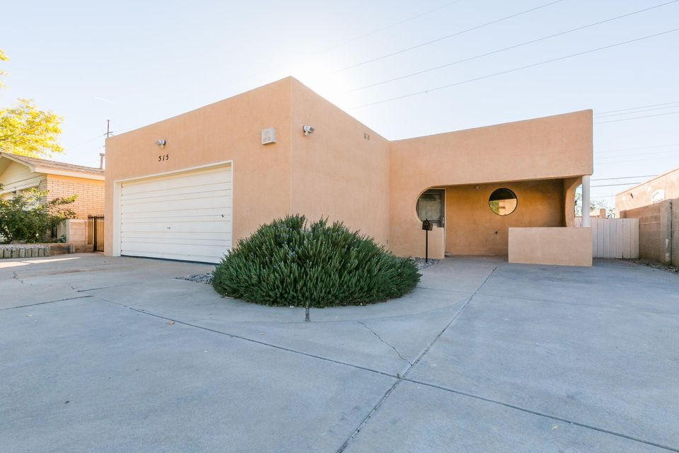 This is a lovely updated home with a light and bright floor plan. New Stucco, freshly painted throughout, new carpet in each bedroom, newer laminate wood floors in the main living areas and kitchen, newer toilets and sink hardware, new light fixtures, blinds, and more! You'll enjoy double french doors as you enter the master with a his and her closet spaces. The kitchen opens nicely to the living area and has a great built in office desk area. The other bedrooms have high ceilings and good closet space. There is a great low maintenance patio yard and shed for storage. This home is near UNM, downtown, and easy access to I-40.