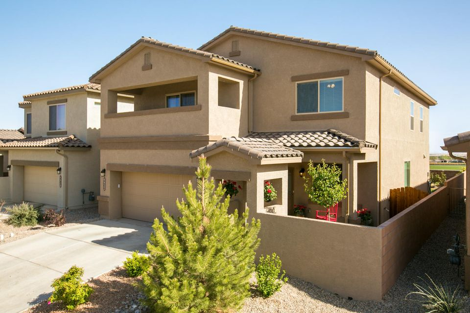 Live Large...There's plenty of room for kids and company in this spacious 2-story/4-BR/2.5-bath home constructed to meet Build Green NM Silver standards.  Downstairs includes a private study, formal dining, spacious kitchen, and a large family room. Perfect for entertaining. Upstairs includes a 2nd living area, 3 bedrooms, laundry room, and HUGE Owner's suite spacious enough for a king bed and sitting area, along with a spa-like bath and private access to a 2nd floor balcony.  Upgrades include stainless appliances, granite counter, enclosed patio courtyard, tile roof and landscaped back yard.  It is easy to enjoy living in this home.   Enjoy nearby nature trails, beautiful parks and great schools including state of the art Volcano Vista high school a short walk away.