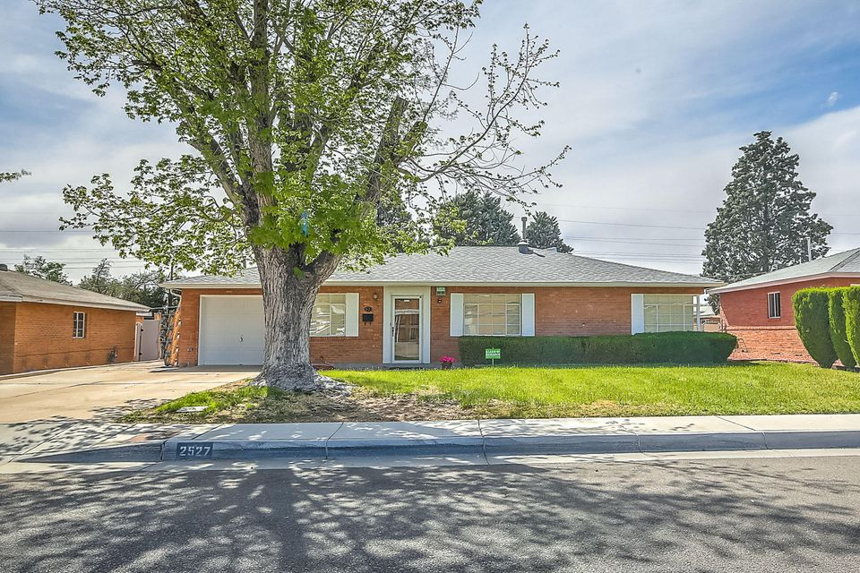 Wonderful well-maintained Hoffman home with lots of updates:  New roof by AAA Roofing 2017, including underlayment, wood supports & gutters.  Warranty transferable for $125. Add'l updates include: Evap cooler 8/17, dishwasher 5/17, Hot water heater 5/16, Sewer line  2001/2002, elec panel & mast 4/2018. Trombe passive solar wall on south side of family room. Spacious floorplan boasts 3BR, 1.75 baths & 27x16 family room with a full mason FP, built in desk &bookshelves.  Kitchen has maple cabinets & ample counter space.  Epoxy coasted floors in laundry & garage. Master with 3/4 bath with new vanity & toilet. Excellent neighborhood in Sandia High School District with close proximity to shopping, dining, community center, Kirtland, Uptown & freeway access. Appliances convey without warranty.