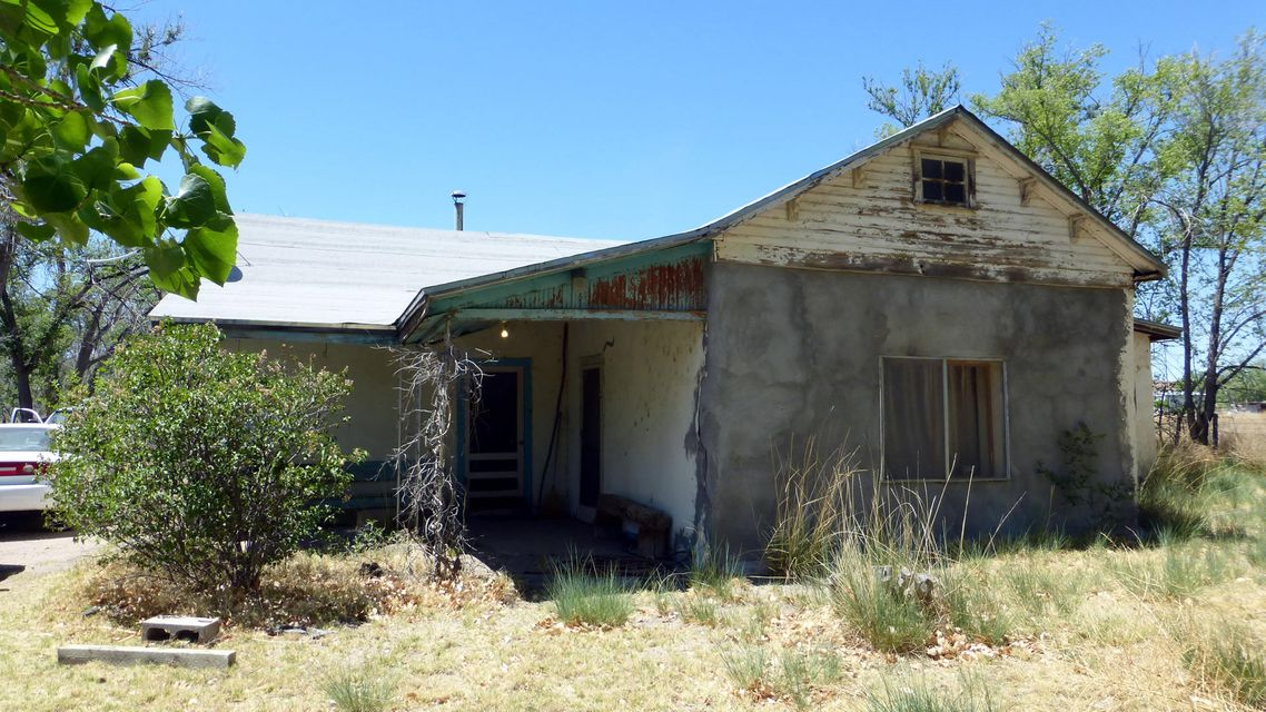 Don't miss this opportunity. Priced at land value. Almost 4 irrigated acres just 30 minutes to Albuquerque. Home is Terrone / Adobe Construction in need of TLC. This is a handyman special. As-is, where is, no repairs at this price. Electric and Natural Gas service. Perfect for horses, there is plenty of riding space behind the property. Mature trees and views of the mountains are part of the beauty of the area. Caretaker present, call your Realtor today for an appointment.