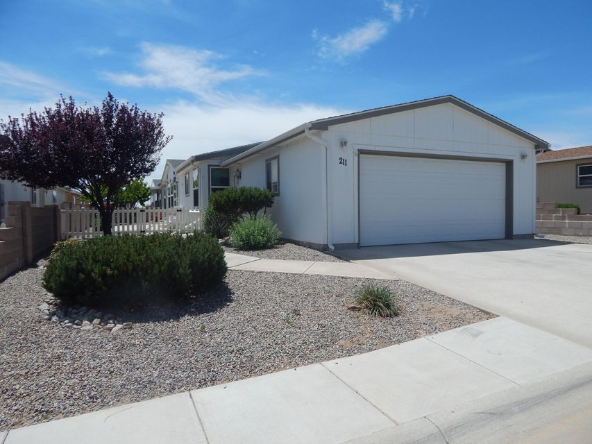 Active 55+ gated community with a large variety of planned activities.  Only 30 minutes south of Albuquerque. Clubhouse has a full kitchen, library, computer room, pond & waterfall, plus a recreation building with enclosed heated lap pool, exercise room and billiards room and a large covered outdoor patio area. Wonderful open light floor plan with 3 bedroom, 1-3/4 baths and lots of skylights. Refrigerated air conditioning will keep you cool all summer long.  Oversize 2-car attached garage. Immaculate and ready for you to enjoy!