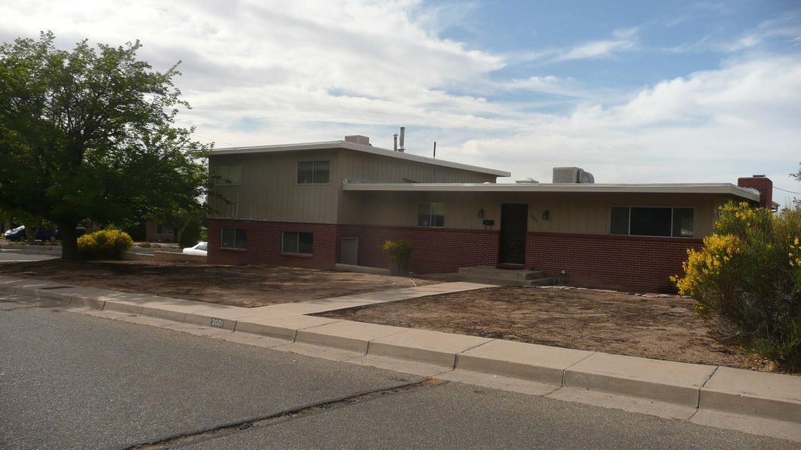 Double corner lot, 4 car garage, large driveway pad for RV parking. Close to Kirkland AFB, Nob Hill, UNM & Airport. Easy drive to downtown. Wonderful neighborhood with 2 parks & golf course nearby. Original hardwood floors (all bedrooms, hall, stairs, study, family & dining room).