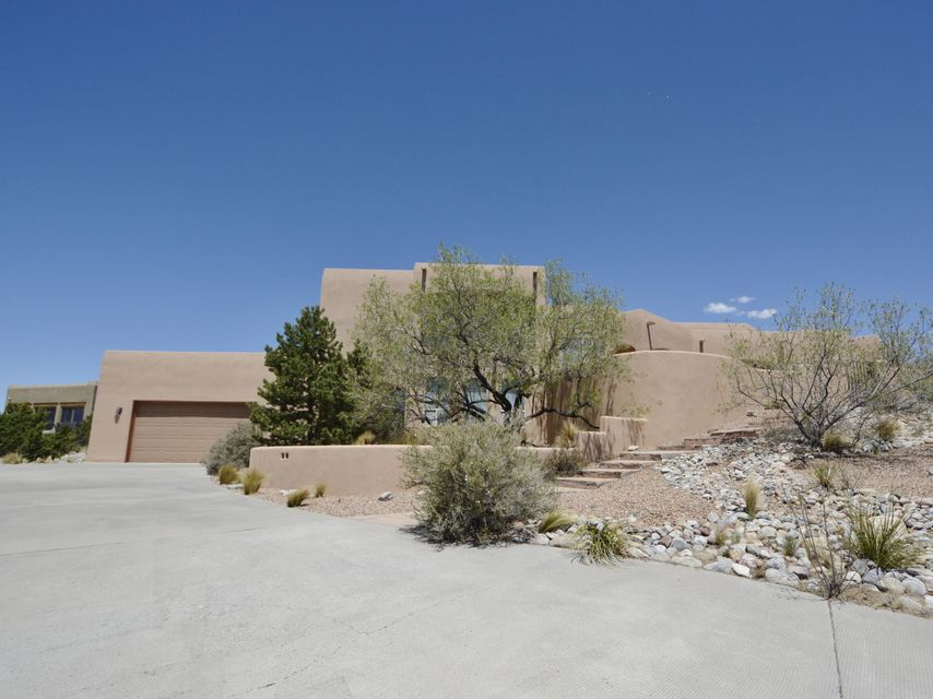 Premier Placitas Home! Strategically sited on elevated lot to take advantage of 360 views! NEW Synthetic Stucco! NM Style that boasts an Open & light filled floor plan w/Vigas & Nichos, Custom Kiva Fireplace, Slate & Wood Flooring. Kitchen is a Chef's dream w/Viking Appliances, NEW sink/faucet/disposal, plus kitchen island w/veggie sink. Private Master Suite w/Spa like Master Bath offering jet tub/snail shower/two separate vanities. Enjoy breathtaking views from two decks. Retreat to Extended backyard living that includes covered patio w/outdoor kitchen grille/hood/cabinet/tile counters, Kiva Fireplace, incredible views, perfect to relax or entertain.