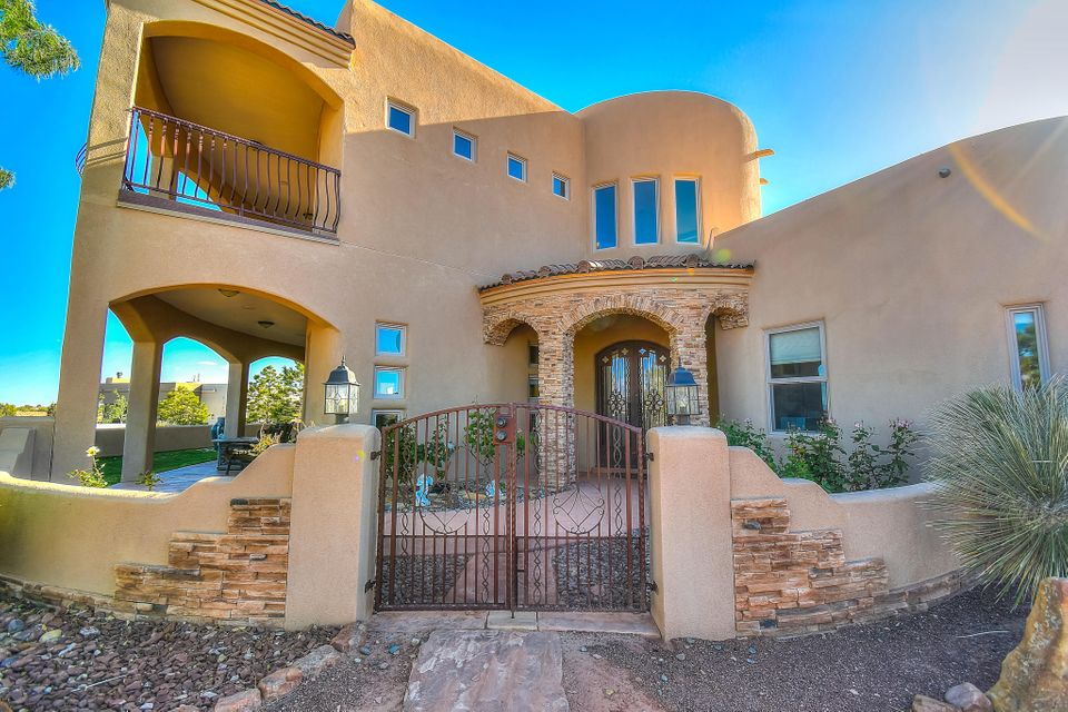 This custom built home boasts of   almost 4,000 square feet with beautiful amenities and details throughout. One of a kind floor plan sitting on one acre with stunning views of the Sandia Mountains, expansive balcony, saltwater solar swimming pool heated, Outdoor kitchen and Landscaping to die for! 3 Bedrooms + an office and a loft/media room. Oversized Master Bedroom with a huge luxurious bath leading to a patio to view the sunsets. Also featuring Radiant heat, Central Forced Heating, Refrigerated Air, Stainless Steel Appliances(included) Fully landscaped, 2 Master Suites, Backyard access, 3 Car Garage + Car Port, A Car lovers dream in a real quiet neighborhood.