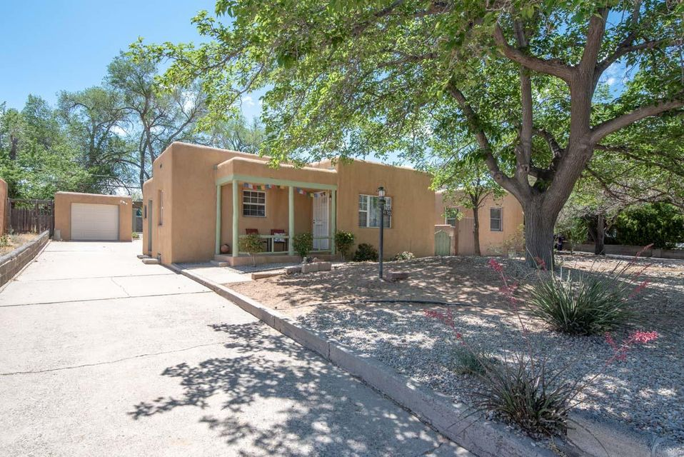 Ridgecrest cutie on nice street located conveniently near UNM, VA Hospital, Kirtland, and Sandia Labs.  Hardwood floors, Large dining room or second living room, 2 bedrooms and one bath. Updated vanity. Updated Kitchen has gas stove, microwave, and refrigerator stays. Beautiful natural light. Thermal windows and Central Forced Air Heating.  Detached one car garage. Backyard access possible.