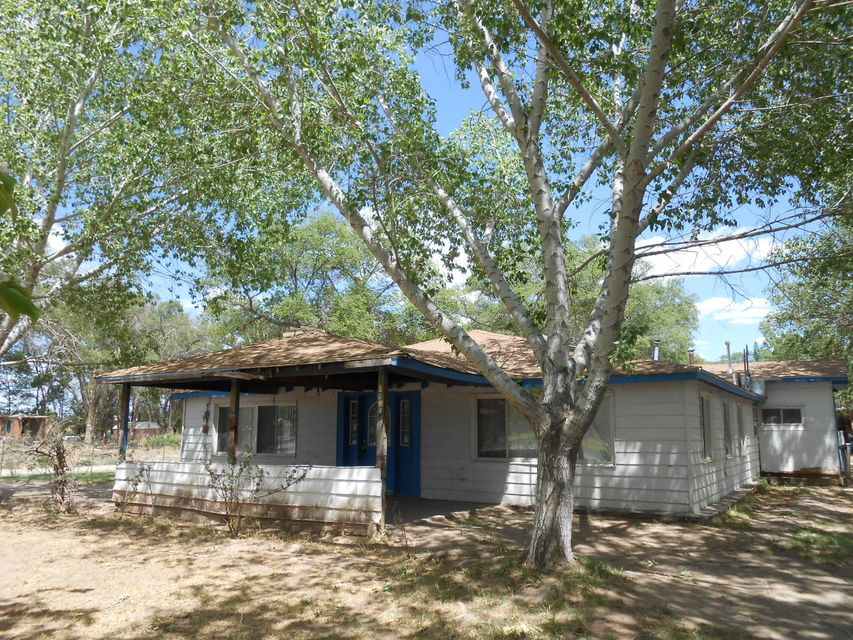 Fenced and gated .50 acre lot with lovely mature trees, a large barn/outbuilding perfect for all your trucks and toys! The home features spacious rooms and is ready for your personal touches.