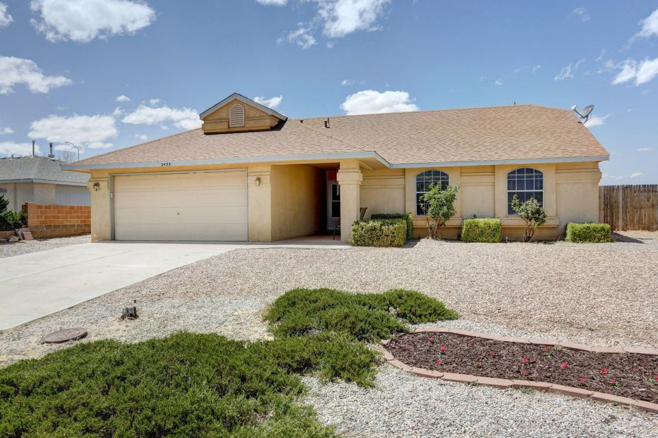 Don't miss this great 3 bedroom/2 bath home in the heart of Rio Rancho!  This warm & inviting home boasts new carpet in the bedrooms, laminate wood and tile in the main living areas.  New granite countertops in the kitchen, large island, & gas stove.  Vaulted ceiling in the spacious living area with a wall of windows to keep this home light & bright.  Large master bedroom & bath with double vanity.  Updates/upgrades throughout including fresh paint, and newer light fixtures.  Huge backyard with storage shed.  Plenty of room for an RV or whatever toys you want to store.  Large covered patio so you can enjoy the outdoors all year long.  **New roof! **  No polybutelene!!  Welcome home!