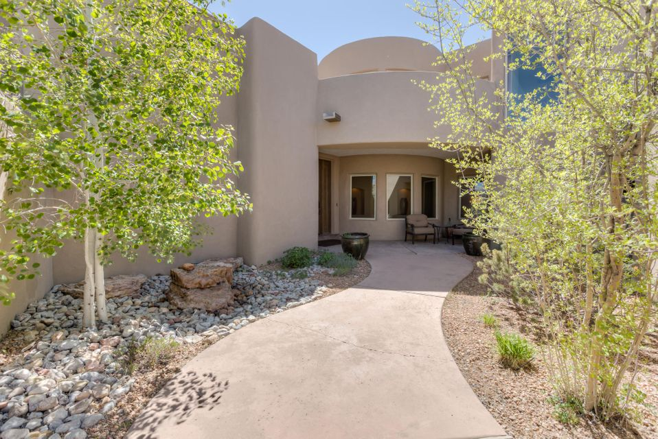 Nestled on a stunning lot at the top of High Desert, this Rutledge built home exudes comfort & style. The main level: 3 guest bedrooms each w/ ensuite bathrooms + walk-in closets, great room, media room & formal dining. The main level also showcases the kitchen w/ custom cabinetry, wolfe & subzero appliances, exterior access + well-planned eat-in breakfast bar/dining area. Upstairs: master suite & office + 2 view decks w/ impressive views! Well-sized MBR w/ 3-sided FP separates the sleeping area from the sitting room- generously sized MBA has double sinks, mini-fridge, jetted tub & oversized shower + walk in closet. 4 Car Garage! Plenty of outdoor entertaining w/ covered patio, built in BBQ, kiva fireplace, water feature & perfect juxtaposition to absorb the striking beauty of the Sandias!