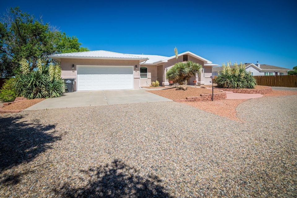 Gorgeous custom home with all the extras you are looking for and just minutes from Albuquerque. Great location at the base of Historic Tome Hill with 1.15 acres, 2,202 sf, 3 bedrooms, 2 baths. Luxurious Master Suite with huge walk-in closet and bath w/2 sinks & fabulous snail shower. Refrigerated air conditioning will keep you cool all summer. Awesome landscaping all on sprinklers/drip system. House well and irrigation well. Enjoy entertaining in the gazebo w/grill & microwave. Plenty of room for parking your RV in the 32x16 steel building. Separate 416 sf workshop with attached workout room. Lots of backyard access for parking all your toys. Country living at its finest but still close to all City conveniences!
