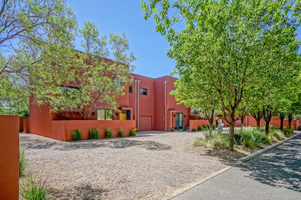 Modern Townhouse, located in the Veranda Compound,  designed by Abq. Architect Christopher Callot.  Oversized wood windows, open concept and high end finishes.  Granite  countertops, slate flooring/surrounds in baths,  gleaming hardwood floors,  refrig A/C, upgraded appliances and more.  Lush North Valley location with access to the irrigation ditch, Abq. Open space,  Rio Grande Nature Centre State Park and Bosque Trails. Second floor balcony off the master bedroom.  Private backyard with outdoor living space and low maintenance landscaping.