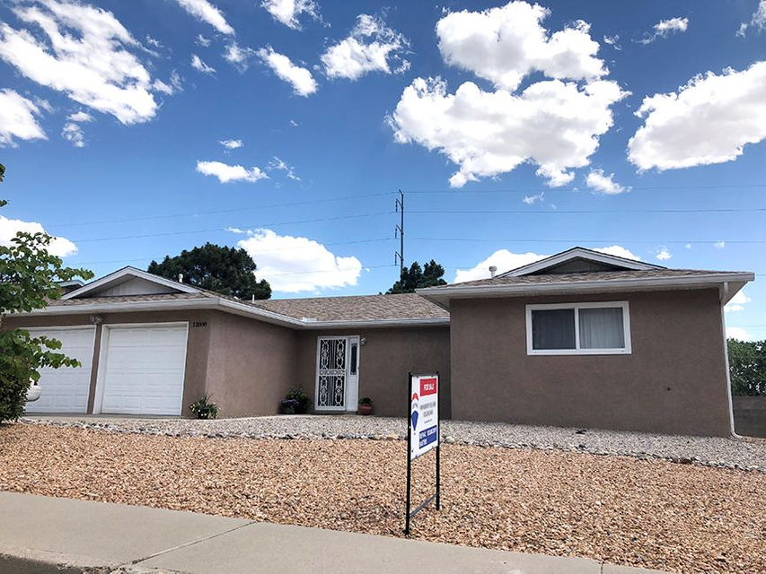 **OPEN HOUSE 6/16 1-3**Gorgeous UPDATED home in beautiful New Holiday Park. Price REDUCED to Sell Fast! Completely updated kitchen with recent cabinets, countertops & Stainless steel appliances. Recent double paned windows, Office/ could be formal dining off living area & entry. OPEN FLOORPLAN - Great room has stacked stone fireplace. Tile floors throughout kitchen, living room, utility room, entry and halls. South facing Sunroom is separately heated and cooled. Lots of light in this beautiful home in move in condition! Bathrooms are recently updated with new vanities. 2 FULL baths - tub in the Master! Mountain view from beautifully landscaped & xeriscaped backyard, convenient to excellent schools, shopping & restaurants (Sprouts, Smiths, Flying star, Starbucks and more).