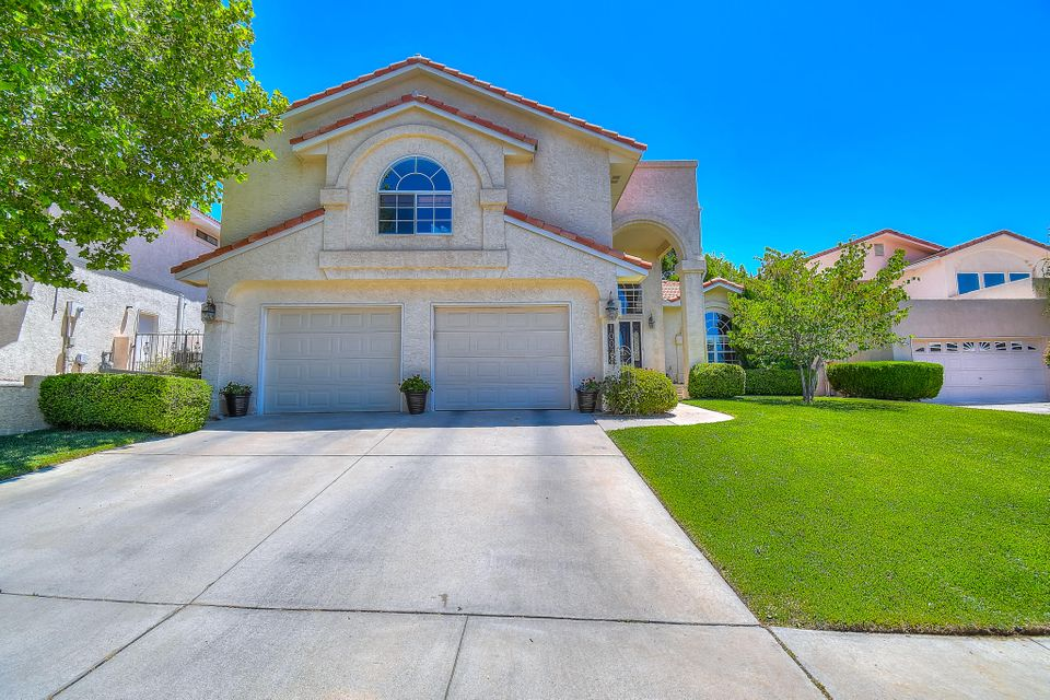 Beautiful Custom Tanoan Home  basking in natural light. This property features 3 living areas, including a fully finished basement (with a bedroom, storage room & large bonus room), a private backyard, and an updated kitchen with granite counter tops and stainless steel appliances. Step into the living room that boasts soaring ceilings and an elegant fireplace with built-in bookshelves and warm hard wood floors. Upstairs you'll find 3 bedrooms and a loft. MBR suite has a spa like MBA w/over-sized glass shower,  double sinks w/ quartz countertops, and a large tub. 1  bedroom and 3/4 bath on main level.  Refrigerated air and HVAC updated in 2016, freshly painted, all bathrooms updated with granite/quartz counters and travertine tile, and carpets cleaned and ready for new owners