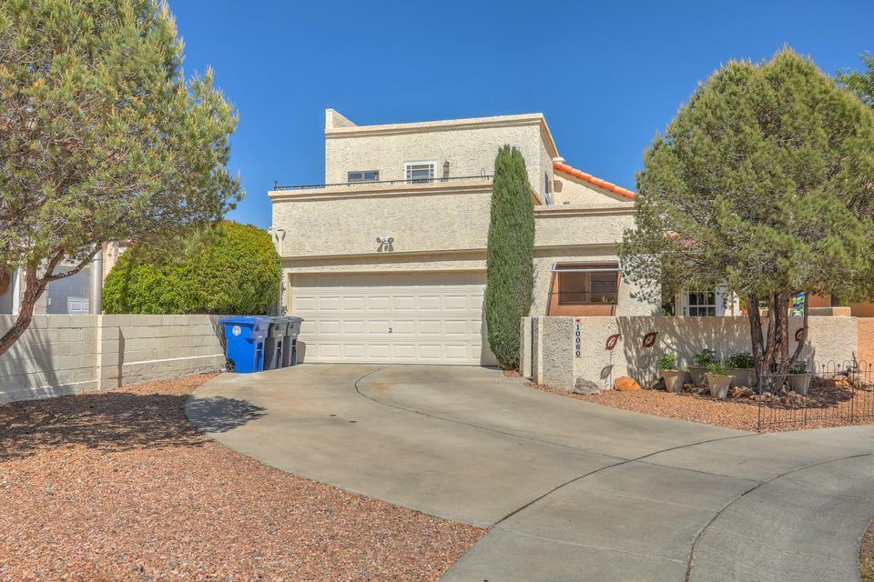 Exceptional Detached Patio Home nestled in a quiet cul de sac. Convenient location with very easy access to shopping, restaurants and entertainment. High ceilings and an abundance of natural light throughout this well designed floor plan. Master suite on the main level is complete with a full bathroom. Two upstairs bedrooms are light filled and one has an enclosed balcony with stunning views of the Sandia Mountains, the other has a great open deck. The backyard overlooks  a large grassy area and has amazing views of the mountain, large two car garage and no HOA! You will not be disappointed, come take a look today!