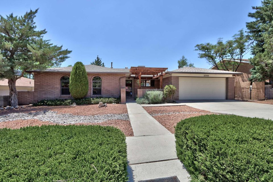 Mountain views, this updated open floor plan boasts both. Move in ready 3+ bedroom, plus two living areas and even a formal dining room. Newer water heater, furnace, Refrigerated air. Wood looking tile floors no carpet. French doors open to the backyard with outdoor living. Kitchen has granite with eat at counter, plenty of cabinets and stainless appliances. Master bathroom updated with beautiful fixtures and granite plus custom shower and double vanity. Master bedroom has 2 walk in closet, access to patio and backyard. Other bedrooms are large with ample closet space. Backyard access for you extra toys. Covered patio. Great location to shopping, walking, hiking and biking.