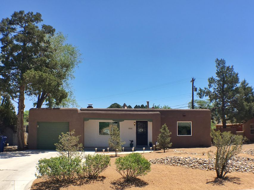 Beautifully remodeled house close to UNM & Nob Hill! This rare gem features a newly remodeled bath, re-finished hardwood floors, open floor plan, and spacious bedrooms. Large grand master suite includes a full bath & walk-in closet. The kitchen features beautiful granite counter tops + stainless steel appliances (w/ gas range!). You'll save money and stay cool with thermal windows and refrigerated A/C (efficiency aided by NEST thermostat!). The large zen backyard has raised flower beds with covered & uncovered patios + side yard access. Single car garage + off street parking for two. This well maintained property is ready for you to make it your new home!