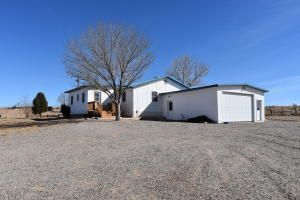Nice Manufactured home with upgrades. This 3 bedroom, 2.5 bath home on 1.25 acres also has an addition for anoffice or possible 4th bedroom, an addition in the back for the laundry room, storage, pantry, or craft area. Large living room and open. Lots of upgrades; light tubes, ceiling fans, metal roofing, multiple evaporative coolers and a 2 car garage.