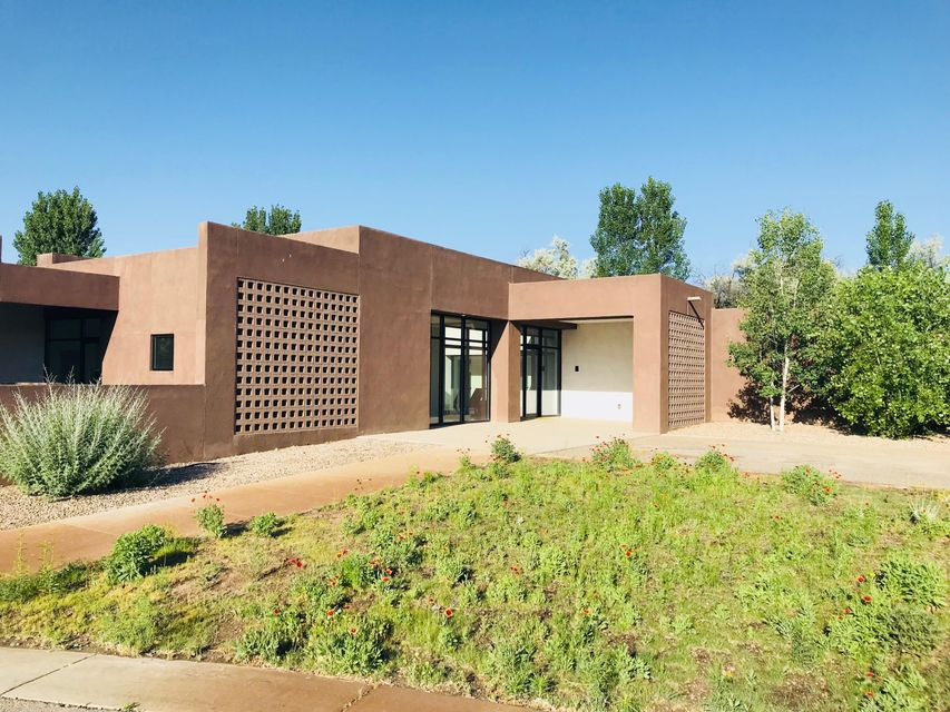 THIS Century Modern by award winner Jon Anderson. Quietly tucked away on  cul de sac near the Bosque trail this dynamic property offers walls of glass, blurring the lines between indoors & out. Center courtyard opens to lap pool. Fireplaces on east & south patios to relax by. Windows & volumes of space in public rooms capture the natural beauty of the setting. Private areas of the residence offer clean, cozy, tranquility. Stunning chef's kitchen with clear maple, grain matched cabinetry, Wolf/Subzero appliances, & large butlers pantry support kitchen for entertaining. Indoor/outdoor surround sound, lighted covered patios, radiant/passive solar heat, refrigerated air add to the comfort of this home. Convenient West Old Town location, a little bit country, a little bit rock n roll!