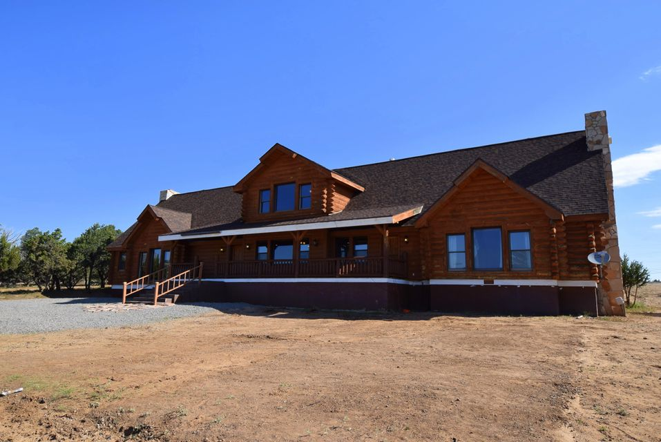 SELLER SAYS BRING US AN OFFER!! Truly a Special Mountain Valley Property!! Spectacular 5074 sq ft Home on 54+ acre horse property w/Barn, at Foot of Sandia Mountains, 20 mins from Alb. Roof done 04/02/2018!!!! Gourmet Kit w/ Granite countertops, SS appliances, Center Island & Pantry. 2 Beautiful fpl, great room w/ 30' ceilings & slate floors.  5 spacious beds each w/ its own full bath & walk-in closet.  Garage is separate w/ 3 bays-center bay set up for hay.  Amazing family home or bed & breakfast/horse ranch/ Mountain get away OR ??  +16 Lots Platted & Deeded!