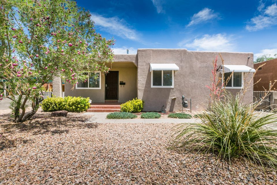 You are sure to love this charming and cozy Ridgecrest home.  There is great character in the hard wood floors, the 2 living areas, and smooth plaster cove ceilings and wall finish.  The updated guest bathroom has a new custom tile shower/tub and vanity area.  The updated kitchen has granite counter tops, gas stove, natural wood cabinets, stainless steel appliances, a pantry, and more. The home also has updates like newer stucco and thermal windows.  The back yard is a great space for entertaining or just enjoying the beautiful Albuquerque weather.  There is a storage shed and open patio area.  It's a lovely home!