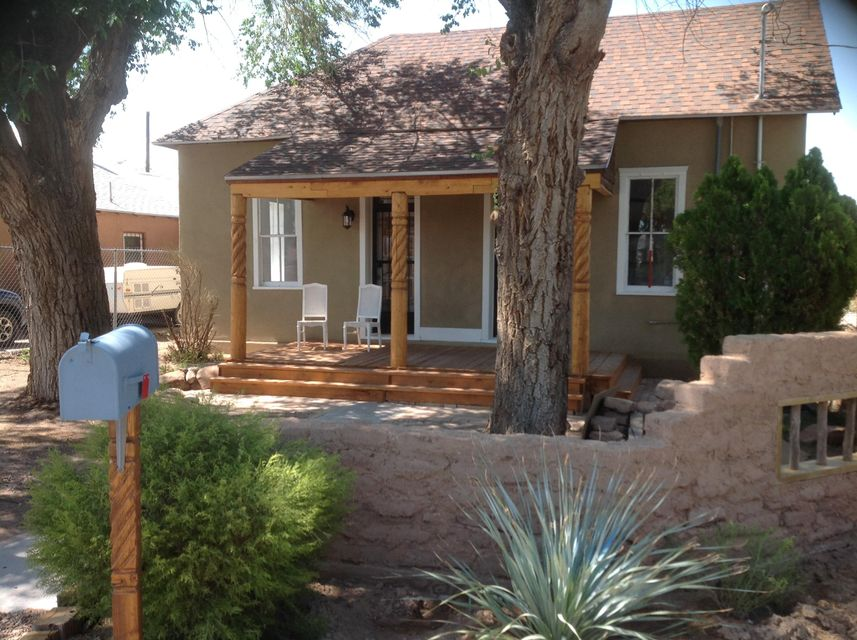 This is pure New Mexico.  Beautifully remodeled 100+ year old adobe in the heart of Sawmill.  Exposed wood beam ceilings, granite counters and hickory cabinets grace a kitchen with ''industrial'' type (Wayfair) fixtures. A stained front porch accesses both living and master suite areas.  Electrical, plumbing and mechanical systems have been completely redone.  House has central forced heating and refrigerated systems.  Large quarter acre yard provides lots of room for expansion or gardens and is graced with artistic pallet fences and Adobe walls.  Easy walking to museums, bakeries, Old Town, pubs and restaurants.  Easily one of the best homes available in the Sawmill district this year.
