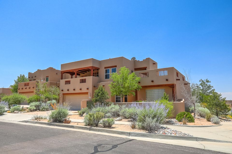 Abundant Outdoor Living Space in High Desert w/ City & Mountain Views! Amenities include: Granite kitchen countertops, stainless steel Sub Zero refrigerator, newer GE stainless steel double ovens/ 2018, Miele stainless steel dishwasher & steam oven, wine refrigerator w/ three cooling levels and a Viking gas range for chefs delight.  Master suite is downstairs and there is a door leading out to open patio where you can relax under the star lite sky and have a glass of wine in the newer Cal Spa hot tub/16 and hear the soothing fountain in the distance.  Large open deck with City & Mountain Views!  Large covered portal for sitting out and watching the thunderstorms in the beautiful sky of  New Mexico.  Living room has tongue & groove ceiling, & viga's.  Ceramic tile (16 x 16) throughout.