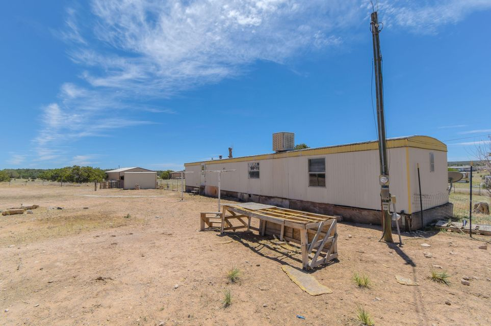 Investors Dream! 1 acre with utilities! Single wide mobile home. 2 bedroom, 2 bathrooms, outbuilding, fenced and cross fenced. Can also purchase the adjoining property at 187 Paradise Meadows, seller will offer a discount!