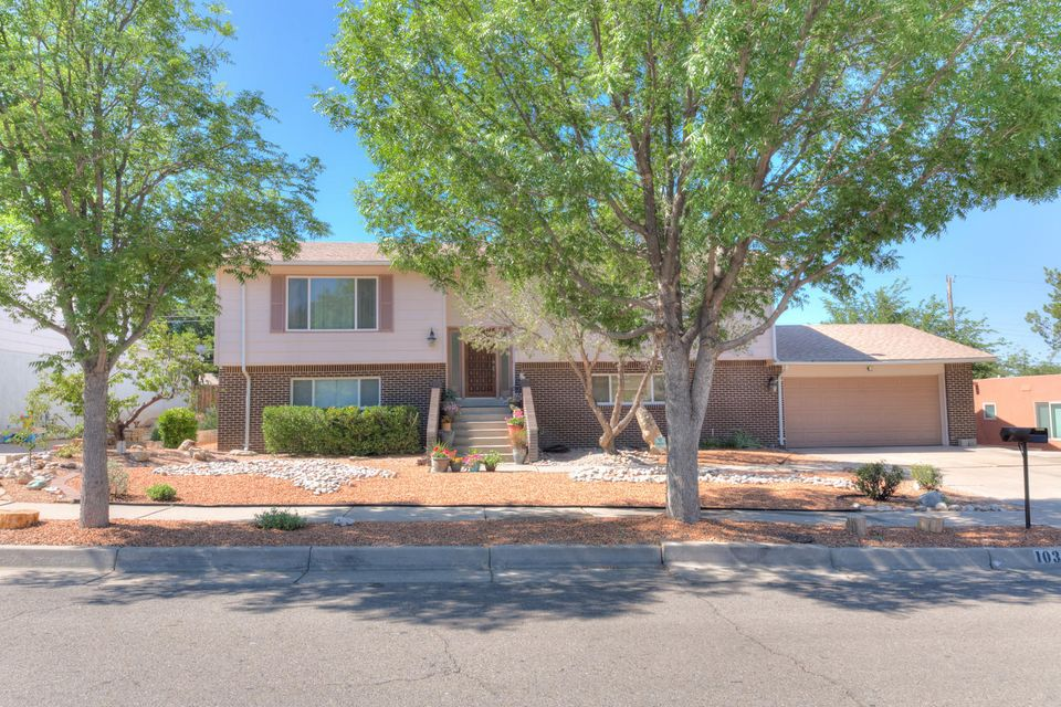 Exceptional | Spacious | Functional 5 BR, 3 BA home in Eldorado district--like new, rebuilt after fire in 2013! Upstairs living area is bright and airy; Superb kitchen has sunny nook + pretty cabinetry/backsplash, granite counters, hardwd flrs--opens to view deck, enjoy your morning coffee there! MBR and 2 other BR's upstairs; 2 BR's downstairs, could be perfect in-law quarters; Wonderful family area downstairs w/ cozy FP. Oversized garage, 2 refrigerated air units, sparkling gunite pool. Popular  NE neighborhood. Shows great!