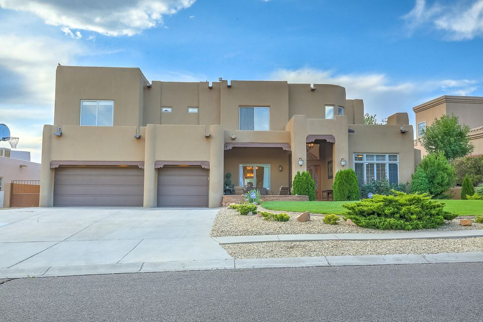 Premier Primrose Pointe living at its best. This home is ready for multi-generation living, entertaining & spacious everyday life. It has 6 bedrooms, each w/its own bathroom access. The new downstairs on-suite casita is ready for visitors, in-laws or a second master, including it's own laundry room. Beautiful remodel has amazing upgrades, from the Chef's envy kitchen w/2 sinks & dishwashers, gas stove & wine cooler, new cabinets & granite counter tops to the remodeled master bedroom, bath & large walk-in closet.  Downstairs has 2 living areas & study, library or music room.  Upstairs-Masters suite plus 4 bedrooms, 3 baths & a living/entertainment room & another laundry room. VIEWS! VIEWS! VIEWS! Views of the spectacular Sandia Mountains, city lights & amazing sunsets.