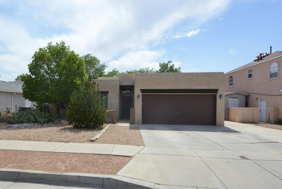 Pride of ownership shows thru-out! Single story Pueblo style home delivers an open concept floorplan with tasteful updates thru-out; featuring 3BDRMS/2 Full Baths(Both with double sinks) & 2 Car garage: The spacious great room showcases raised T&G ceilings with wood beam accents, Kiva fireplace-creating peaceful ambiance. Beautiful Remodeled kitchen (2014) features Quartz Countertops, updated stainless steel appliance-2014 & plenty of cabinet space. Additionally, seller has installed NEW Windows thru-out in 2010 by Renewel by Anderson. New Membrane Roof in 2012, NEW Refrigerated Air in 2007, Re-stoccoed in 2014 & NEW Dryer 2018, NEW carpet in 2017 to name a few-see See sellers Improvements in Flex-Docs!! Backyard features covered Patio & ample space-Perfect for relaxing or Entertaining!