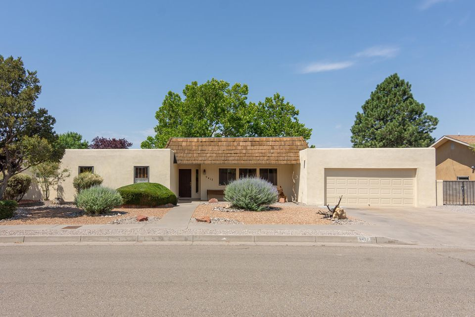 Fantastic single level, 4 bedroom residence, located on a .27 acre lot, in a high demand NE Heights neighborhood (Academy Estates) just minutes to grocery shopping, Starbucks, Albuquerque Academy, golf courses & parks! Discover generous spaces, perfect for relaxing & entertaining; formal living & dining room; family room enhanced with gas log fireplace, wet bar & double French doors opening to the delightful heated/cooled sunroom! Spacious kitchen offers corian counter tops, double ovens, breakfast bar & nook with views of the beautiful backyard! Enjoy the evenings under the large covered patio & shady backyard with mature trees. Double doors open to the master bedroom; walk-in closet with built-ins! Tile floors in bathrooms! Refrigerated air! Storage shed, View deck! BACK YARD ACCESS!