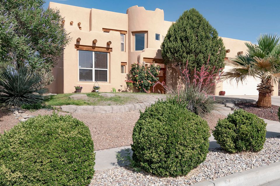 GREAT NEW PRICE!Enter through the private courtyard to this lovely pueblo style home in a great location! This home has a great floorplan with the Master and a second bedroom/office with courtyard entrance on the main floor. Home features formal and informal dining and a kiva fireplace in the living area. The natural light pours into this home. There are soaring ceilings in the entry and living room. The upstairs has two more bedrooms, a study/playroom and loft. The master and upstairs bathrooms both have double sinks. Yard has nice landscaping and automatic sprinklers. Home backs to Open Space. Come take a look!