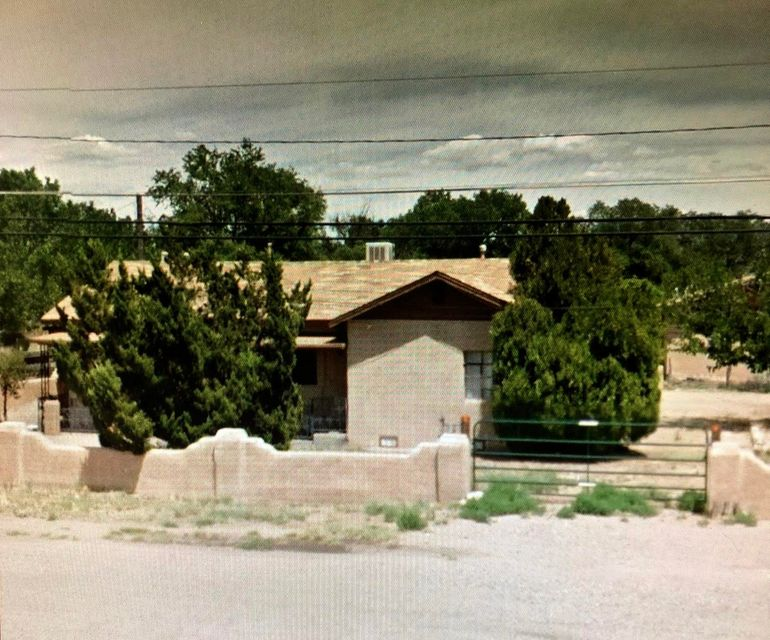 Nice opportunity to own a 2 bedroom home with a 1 bedroom apartment attached.  The apartment has a separate entrance and kitchen.Apartment rents for approximately $600  mo.LR: 13x12, Kit: 13X7. Bed: 13X11
