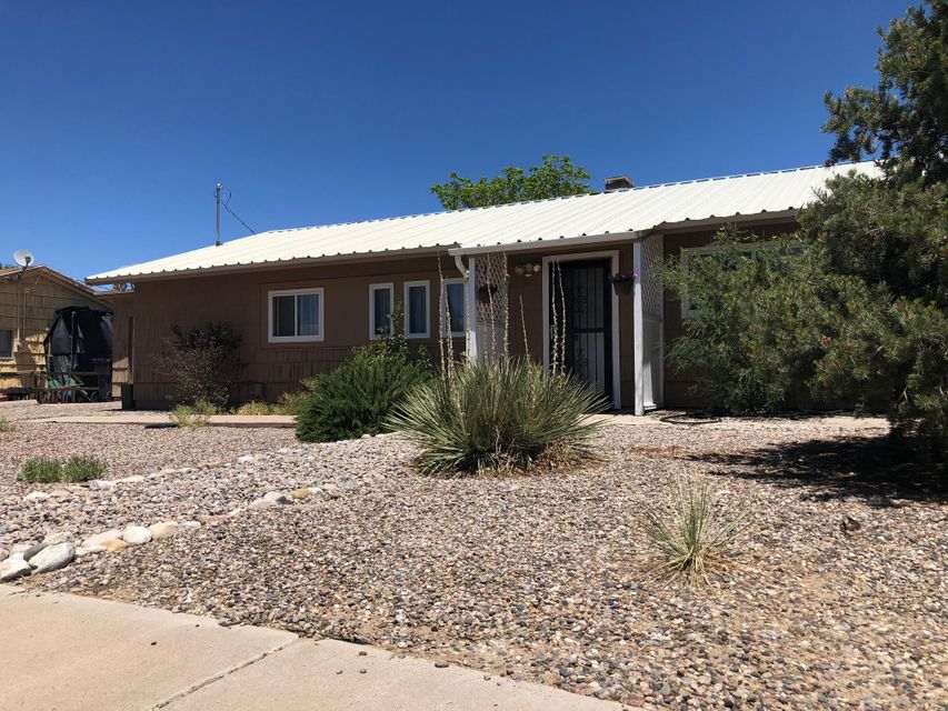 Come see this cozy 3 bed 1 bath home in the NW with Beautiful views and a huge lot! Updated kitchen and bathroom. The back yard fully fenced and landscaped.