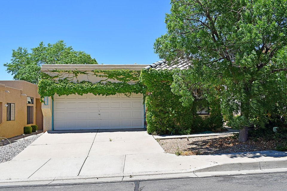 You're going to LOVE this neighborhood, good schools, great location, quiet cul de sac street! This home has so much to offer. 2 Bedrooms plus office, which could be a 3rd bedroom, spacious, light filled living and dining room combo, and split master suite make this an ideal floor plan. Recent improvements include newer roof,new paint, countertops, fixtures and so much more. Easy care tile floors throughout. High ceilings make this one feel so open. Let us introduce you to your new HOME!
