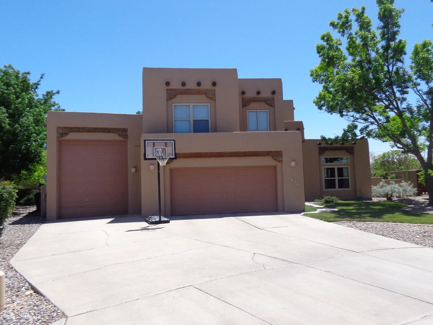 This beautiful custom home not only has 4 spacious bedrooms plus 3 Baths, 2+ Living Area is light and bright nestled in Cul de Sac in the Meadows on Rio Grande, BUT it has an attached RV GARAGE!!. Biking/walking distance to the Bosque Trails,walking distance to the CoOp for shopping. Downstairs Bedroom can also be office/study. Spacious Master with remodeled Master Bath upstairs, plus two more spacious bedrooms upstairs with full bath. Yard is beautifully landscaped w/east facing covered patio for outdoor dining. All new stainless steel appliances. Pre listing Inspections completed, Full Home, Termite/Dry Rot, Sewer Scope. Repairs completed. CLA for details and copies of reports. Very well maintained with some updates!