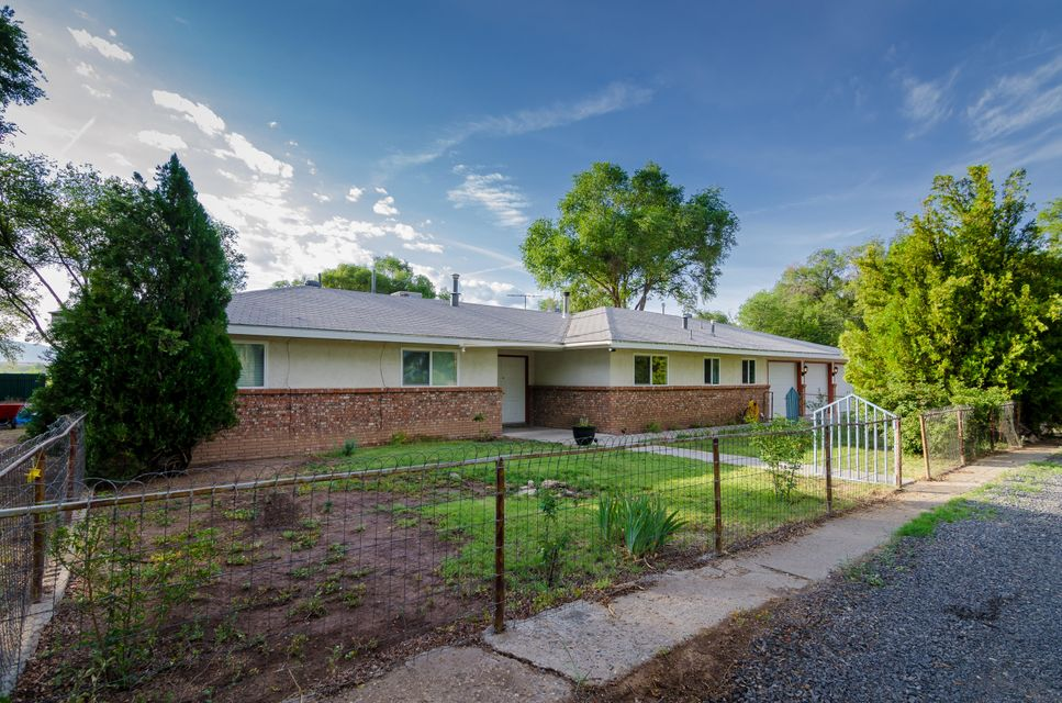 Beautiful ranch home in a quiet secluded area of Peralta overlooking the gorgeous Manzano Mountains. 2+ living areas, heated sunroom and outdoor pool, this home is perfect for relaxing or entertaining.  The kitchen has a large breakfast bar, dining area and a wood burning stove for those cold winter days. New windows, fresh paint throughout and updated bathrooms, this home is sure to please.  The second living space could easily be used as a 4th bedroom, office or hobby room. Oversized three car garage and two storage buildings to store all your toys.  Spend time in the backyard swimming or just relaxing on the deck...the views are incredible!  Come take a look for yourself!