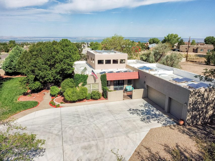 Remarkable NAA home w/automated gate entry. The beautiful manicured front and side yards are lush w/vegetation, raised garden beds, and all on auto drip/sprinklers. Stunning mountain views abound from this .89 acre lot. The yard has RV hookups with 30amp pwr, separate finished shop w/loft storage and 220V. The interior boasts 3 large bedrooms, loft w/wet bar and balcony overlooking mountain and city views, huge master suite w/spa like bath. The great room features clerestory windows, gas log fireplace, wet bar, and gorgeous wood floors. The large updated kitchen is bright, open, w/ample cabinet space, island w/seating, double ovens, and mountain views. The home features 4 ton Daikin energy efficient heating/cooling units w/individual room controls and solar power with a net gain.